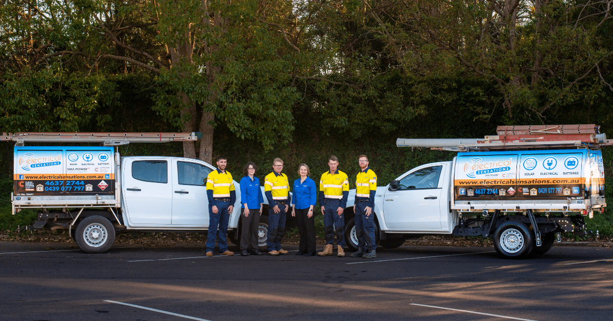 ELECTRICAL SENSATIONS TEAM STANDING IN FRONT OF WORK UTES. TOOWOOMBA'S LOCAL SOLAR INSTALLERS